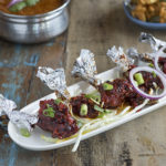 Chicken Lollipops dressed with spring onions | Delhi Belly Indian Restaurant